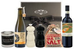 A premium bottle of red wine, Le Creuset salt and pepper mills, Australian salt & pepper and organic olive oil all packaged in our signature black hamper box